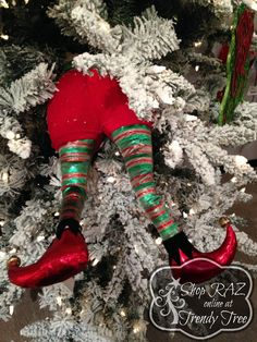 "RAZ Shiny Elf Butt with Legs      Made of Polyester     Measures 20"" X 9.5""      RAZ Exclusive  RAZ 2015 Merry! Merry! Merry! Collection  This item is on order and arriving Summer 2015"