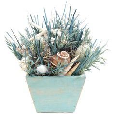 Artful on its own or anchoring a beach-chic vignette, this eye-catching arrangement features avena, turquoise grass, white starfish, and assorted shells.