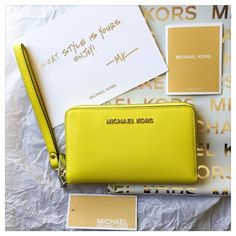 "NWT Michael Kors Jet Set Large  Wristlet   Authentic NWT Michael Kors Jet Set Travel Large Saffiano Leather Smartphone Wristlet in Canary Yellow w/ Silver Tone Hardware  MK Style #32H4STVE9L  Brand new w/ tags, perfect condition, never used!  Dimensions: 6.5"" x 4"" x 1""  Gorgeous bright yellow Saffiano leather Wristlet, big enough to fit an iPhone 6!  7"" Strap Drop - Strap is removable to convert wristlet to wallet!  Interior: fabric lined w/ bill fold, coin pouch, ID slot & 5 card slots  No…"