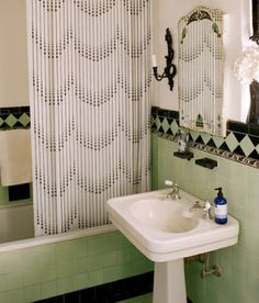 Art Deco bathroom with green and black tile