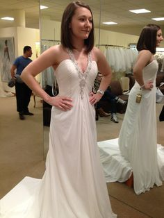 This is an ivory demetrios plunging neckline light weight dress. The Neckline and t-back are embellished w/jewels. The dress is fitting up top, and then effortlessly flows down, with a Cathedral lengt