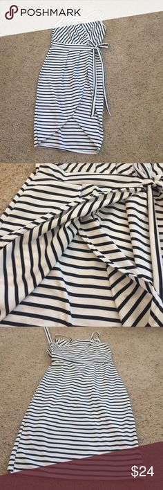 Black and White strip Dress Bought from another posher. No tags but I would say it's a small. V neck. Very big slit in the front. Super cute! Dresses