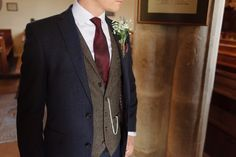 Groom wears a navy blue suit with brown tweed waistcoat and burgundy tie | Photography by http://www.gabriellebower.co.uk/