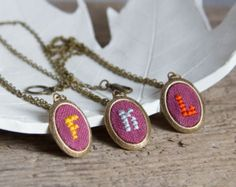 This playful Personalized initial necklace is an enjoyable piece in vintage style. Each colorful hand embroidered monogram looks really special and delightful. It is a wonderful jewel for any vintage style lover!  The listing is for ONE necklace.  ***Personalization options*** ---Initial--- You can see patterns for all letters on the last image. I can make any letter you want. ---Color--- I have plenty of color embroidery flosses, let me know which color do you prefer and Ill use it for…