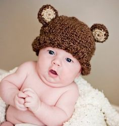 posing ideas for 2 month old. Have mom/dad cover arms with blanket then hold baby. Baby looks like sitting up on own