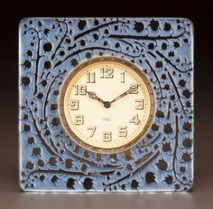 R. LALIQUE CLEAR GLASS MUGUET CLOCK WITH BLUE PATINA Circa 1926. Molded R. LALIQUE