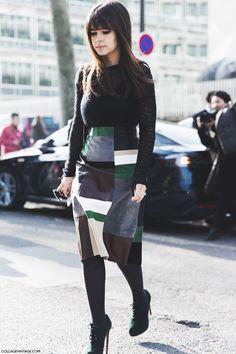 black turtleneck + black, gray, brown, white, green, and cream leather midi skirt