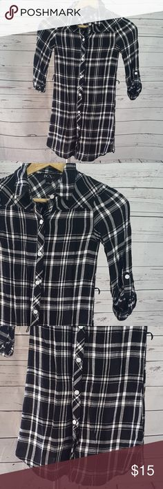 """BCX Girl black white plaid shirt dress/tunic BCX Girl black and white plaid shirt dress/tunic with button-up cuff sleeves, button-down and collar. Dress has belt loops for your choice of belt or no belt. Excellent pre-owned condition from a smoke-free home.  Size 10  Measurements are approximate (laying flat): armpit to armpit: 13 1/4"""" shoulder to hem: 25 1/4"""" shoulder to cuff: 13""""  B5 BCX Dresses"""
