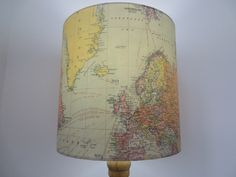 A personal favourite from my Etsy shop https://www.etsy.com/uk/listing/251847543/drum-lampshade-vintage-world-map-paper