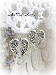 Heart shaped, Angel feather wing earrings. Sterling silver jewelry.