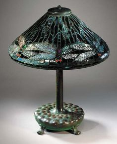 A 'DRAGONFLY' LEADED GLASS AND BRONZE TABLE LAMP   Tiffany Studios, circa 1910   21¼in. (51.4cm.) high, 16in. (40.6cm.) diameter of the shade, with finial  the base stamped TIFFANY STUDIOS NEW YORK 546