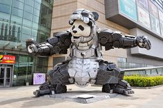 'Iron Panda' by Bi Heng, is 9 meters high and 7 meters wide. The statue is displayed in Shenyang, Liaoning province of China, and is a wonderful mishmash of panda, Marvel's charming alcoholic arms-dealer-turned-superhero Iron Man and Chinese culture. Shenyang, Iron Man Suit, Iron Man Armor, Kung Fu Panda, Video Panda, Nave Star Wars, Bear Statue, Panda Love, Photos Of The Week
