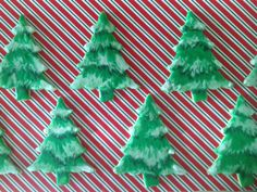 Iced sugar cookies decorated as snow capped trees for Christmas/winter.  My favorite Christmas trees!