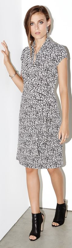 Dotted with graphic circles, this classic Cascade Wrap #Dress is styled with short sleeves for the Spring season.
