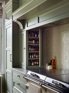 Hobs and oven mantle, with spice cupboard build discreetly in to the side