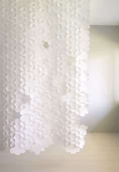 Mia Cullin,Flower shaped pieces from Tyvek joined together to make curtains or room dividers with three dimensional surfaces. 160 pieces in one package.