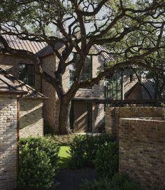A beautifully reimagined lake house boasts serene views over Lake Austin