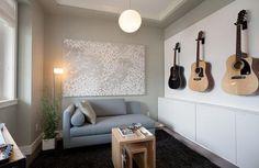 guitar hanging in basement