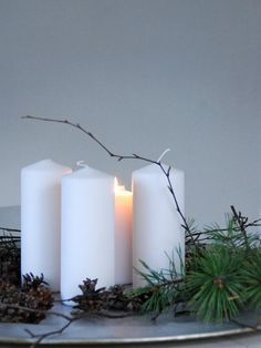 Loppelilla pillar candles and pine branches Norway Christmas l Gardenista