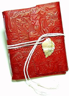 Hand Sewn Filigree Embossed Cherry Leather Journal. $79.00, via Etsy. by OldWorldJournals