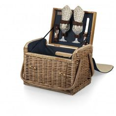 "Kabrio Deluxe Wine & Cheese Willow Basket - Dahlia. The Kabrio - Dahlia is like no other wine basket you will find. Made of willow with a soft insulated cover, it features an integrated wooden table top, perfect for resting wine glasses or food items. It includes: 2 hand-blown wine glasses (7 oz.), 2 napkins (14"" x 14"", 100% cotton, Botanica Leaves design), 1 hardwood cutting board (6 x 6""), 1 stainless steel cheese knife with wooden handle, and 1 stainless steel, waiter-style corkscrew."