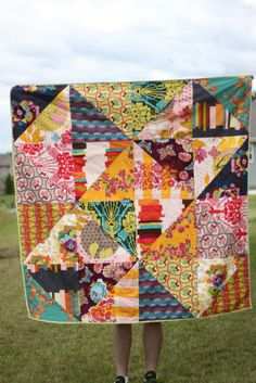 "triangle quilt. make it 48x60 (twenty 12"" squares) use the magic square method and ten different FQs...I think."