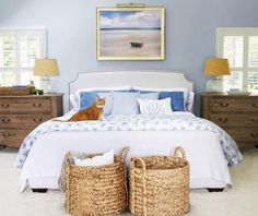 LOVE the idea of 2 small dressers as night tables! You'll stay cool, calm, and collected in this tranquil beach house bedroom Beach House Bedroom, Home Bedroom, Bedroom Decor, Bedroom Chest, Serene Bedroom, Bedside Chest, Wicker Bedroom, Dream Bedroom, Modern Bedroom