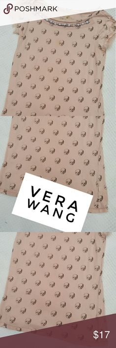 VERA WANG SKULL TEE SMALL Pre-loved skull top by Vera has capped sleeves which are Fringed at ends in excellent condition beautiful jeweled neckline would look great paired with jeans,leggings or a skirt Vera Wang Tops Tees - Short Sleeve