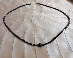 faceted black antique glass round NECKLACE faceted black crystal rondells, sterling silver lobster clasp on Etsy, $53.00