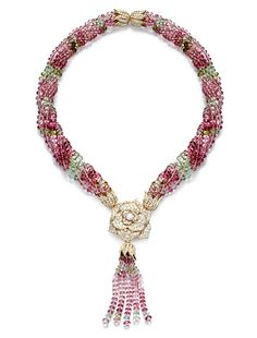 Piaget Rose Passion Tassel Necklace with pink sapphire tassels hanging from the signature Piaget diamond and gold rose.