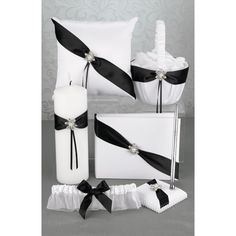 Shimmering Twilight Collection - White satin wedding set accented with black satin sash and rhinestone and faux pearl. Collection includes ring pillow, flower basket, guest book, unity candle, pen set, and garter.