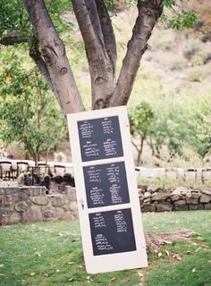 We are LOVING this chalkboard seating chart. Photography by jessicalorren.com