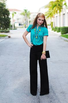 Love the color of the top with the necklace. Wide leg pants are awesome especially with the high waist
