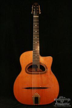 1932 Selmer Macaferri D-hole guitar w/ a cedar top.