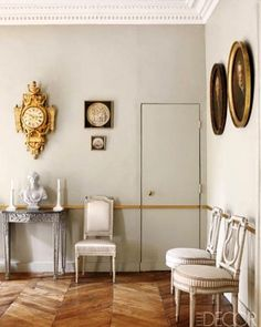 Paris apartment of Andrew Gn - In the dining room, grisaille drawings hang above a Louis XVI painted chair; the oak floors and molding are original. Decor, Home Interior Design, Elle Decor, Interior Barn Doors, French Interior, Interior, Swedish Interiors, House Interior, Paris Apartments
