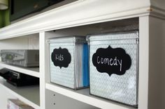 Organize DVDs into DVD boxes from The Container Store - use chalkboard labels to identify what is in them!  LOVE
