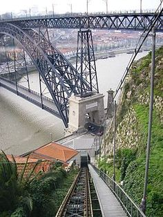 The Funicular dos Guindais is perhaps the most notable method of transport in Porto, Portugal, and is as much of an attraction in its own right as it is a means of travelling from one part of the city to another. Visit Portugal, Portugal Travel, Spain And Portugal, The Beautiful Country, Beautiful Places, Great Places, Places To See, Plan Incliné, Portuguese Culture