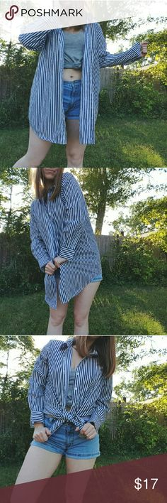 """Oversized Striped Button Down Blouse Wear it loose or tie it up and show off those curves !  Womens size medium, fits like an extra large Sleeve length 32"""" Armpit to armpit 23"""" Length 32"""" Model is 5'6 for reference   Now accepting offers on bundles ! One low shipping rate no matter how many pieces are bundled 💕 Tops Button Down Shirts"""