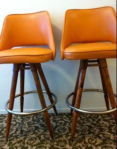 MID CENTURY PAIR orange naugahyde vinyl wood barstool Calorator Danish Eames era mod Mad Men chair dowel legs by TheAvidDiva on Etsy https://www.etsy.com/listing/106391518/mid-century-pair-orange-naugahyde-vinyl