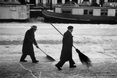 1964. Volunteer winter canal cleaners are making way for ice skaters on one of the canals in Amsterdam. Photo Leonard Freed. #amsterdam #1964 #canals