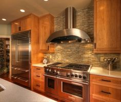 Modern Island Style kitchen, oak cabinets, Adrienne Nienkamp at Mosby Building Arts, Other