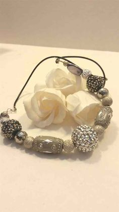 Silver and gray beaded necklace with rhinestones