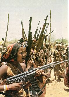 Women of the Western Somali Liberation Front hold a rally with a menagerie of small arms during the Ogaden War in Eastern Ethiopia. The women in front holds a Stg 44 African Culture, African History, Afrique Art, By Any Means Necessary, African Diaspora, East Africa, Art Plastique, African Women, Black History