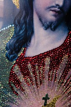 An image of Christ unabashedly adorned with sequins and glitter, created by local nuns. This dazzling decorated image of Christ is displayed in tribute to the miracle of San Juan Nuevo in Mexico.
