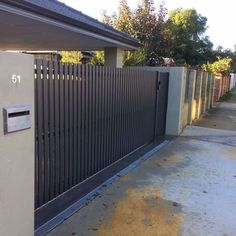 Vertical slats have more privacy than horizontal ones. Definitely a better option Western Automate's Vertical Aluminium Slat Picket Style Sliding Vehicle Gate to match clients existing fence line. Automated with Centsys Evo , Infrared Sensors & Keypad. Fence Gate Design, Steel Gate Design, Front Gate Design, Main Gate Design, House Gate Design, Door Design, House Front Gate, Garage Gate, Front Gates