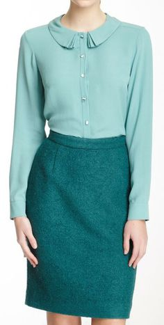 Orla Kiely colour blocking. Aqua blouse with fancy collar, turquoise pencil skirt. With neutral flats and bag.