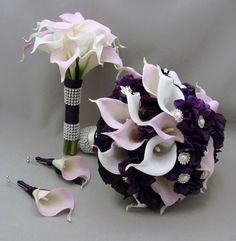 This custom real touch wedding flower package features lavender and white calla lilies with deep purple hydrangea accents and a bit of bling with rhinestone and pearl accents. I can create it for you as shown or customize it to fit your color scheme. We can work together to create a custom silk flower wedding package for your entire wedding party with your custom bridal bouquet, grooms boutonniere, bridesmaids bouquets, mothers corsages, flower girl basket, ring bearer pillow or boutonniere…