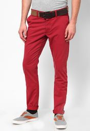 Bend the rules in style wearing these red coloured chinos from Being Human with a matching T-shirt and funky sneakers. Featuring slim-fit these chinos will surely become your second skin.