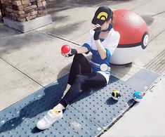 A few of the Targets painted some of the round sculptures out in front of the store as a Pokeball! My mom took this photo lol Pokemon Go - Pokestop Megan Coffey, Pokemon Cosplay, Pokemon Go, Deviantart, Cosplay Pokemon