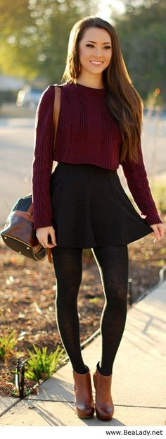 Shop this look for $106: http://lookastic.com/women/looks/cropped-sweater-and-skater-skirt-and-crossbody-bag-and-tights-and-ankle-boots/3820 — Burgundy Cropped Sweater — Black Skater Skirt — Dark Brown Leather Crossbody Bag — Black Wool Tights — Brown Leather Ankle Boots